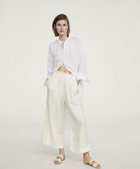 Pantalon jambe large volant lin