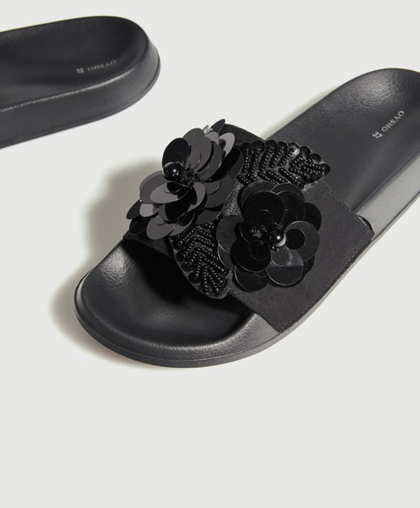 Slides with floral appliqués