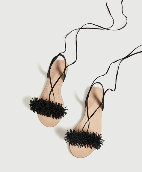 Lace-up sandals with fringe