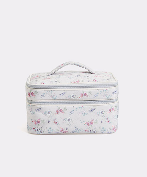 Quilted floral toiletry bag