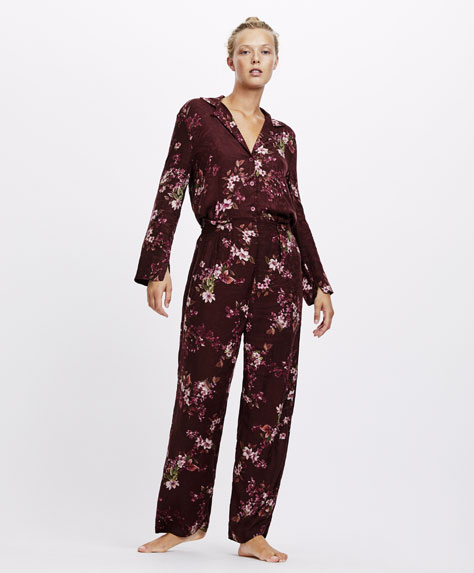 Maroon floral print trousers