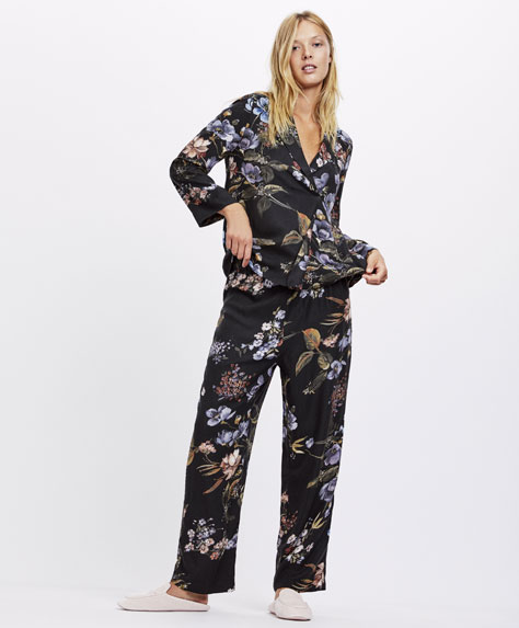 Floral trousers with black background