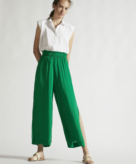 Satin finish trousers with slits