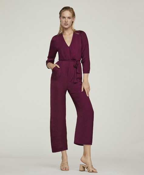 Lang jumpsuit med satineret finish