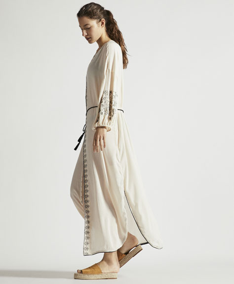 Long white embroidered tunic