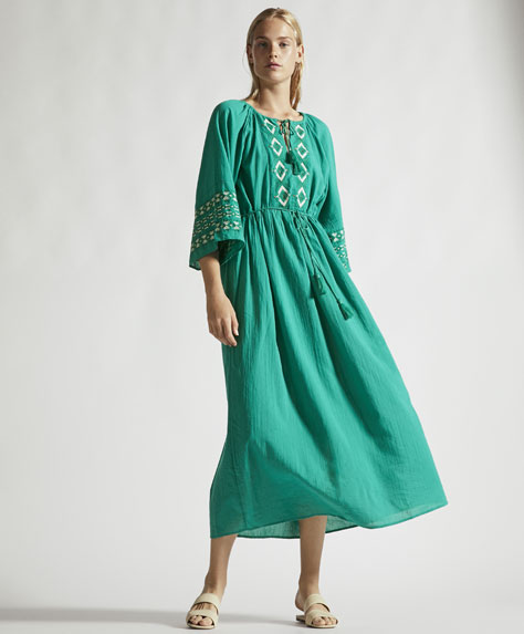 Long green embroidered tunic