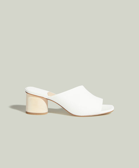 Asymmetrical high heel mules