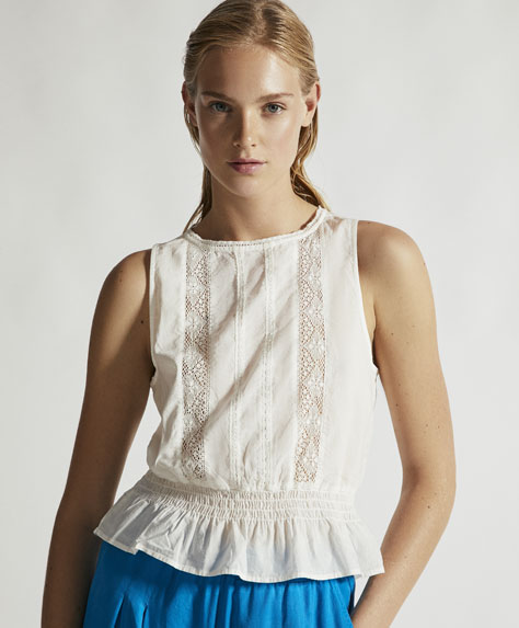 Sleeveless top with lace trims