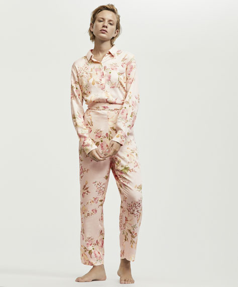 Floral trousers with pink background