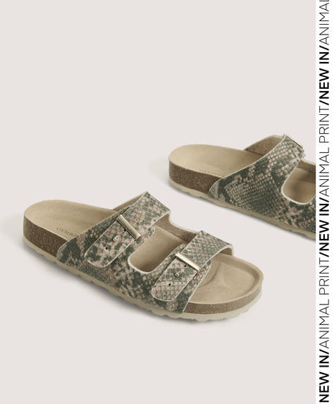 Animal print sandals with buckle details on the upper. Sole height: 2.5cm