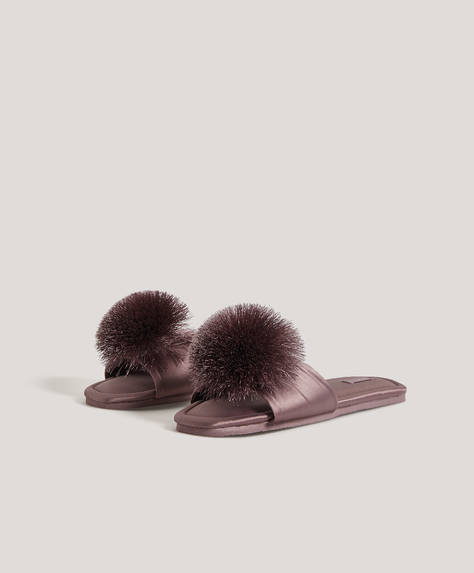 Dark pink satin slides with pom-pom detail on the upper. Sole height: 1cm