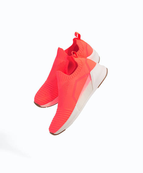 Fluorescent coral sock trainers