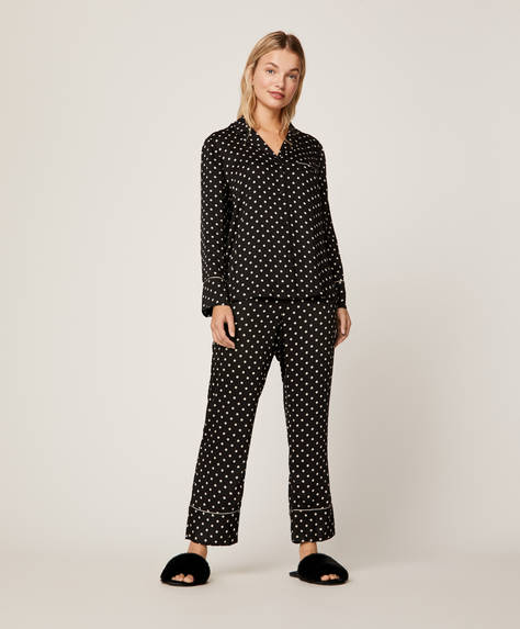 Polka dot trousers with black background