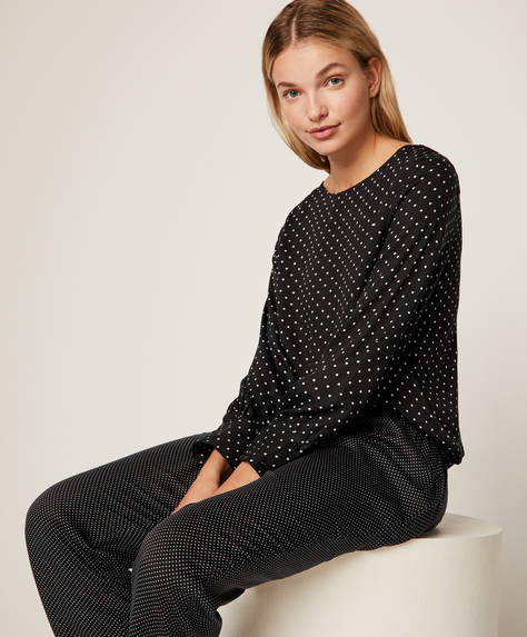 Ditsy polka dot trousers with black background
