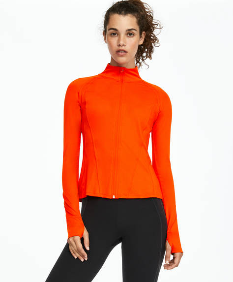 Orange technical jacket for outdoor runs