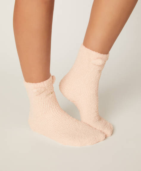 Boîte souris rose contenant des chaussettes