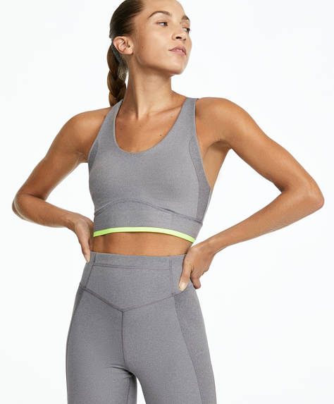 Sports bra with compression tapes