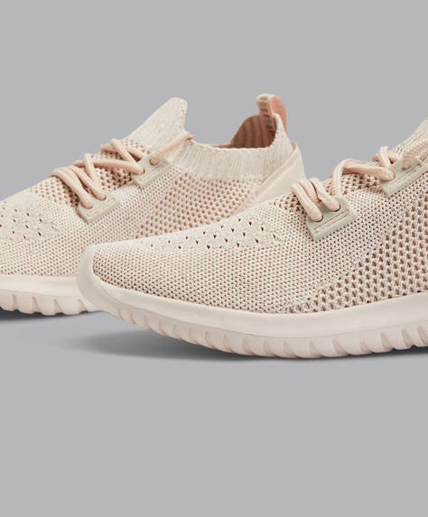 Pale pink sock-style trainers