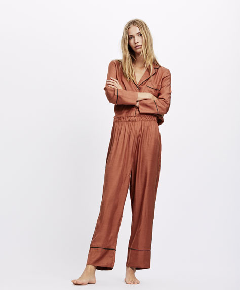 Terracotta trousers with piping