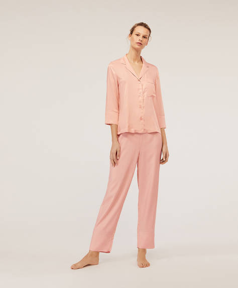Trousers with pink piping