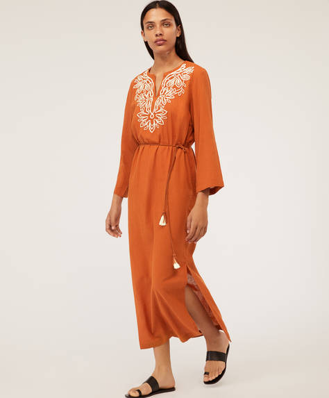 Long embroidered tunic with puff sleeves