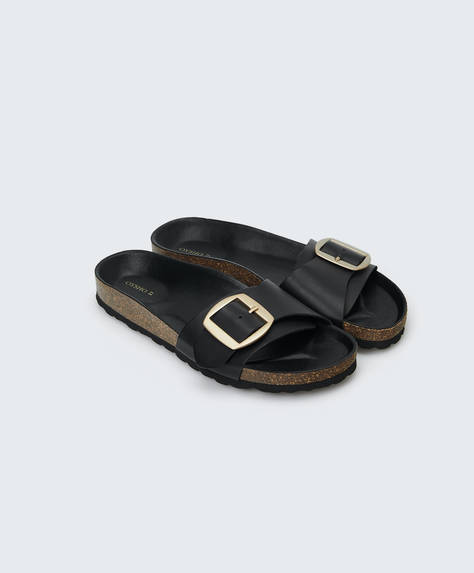Maxi-buckle leather sandals