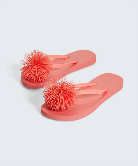 Coral pompom beach thongs