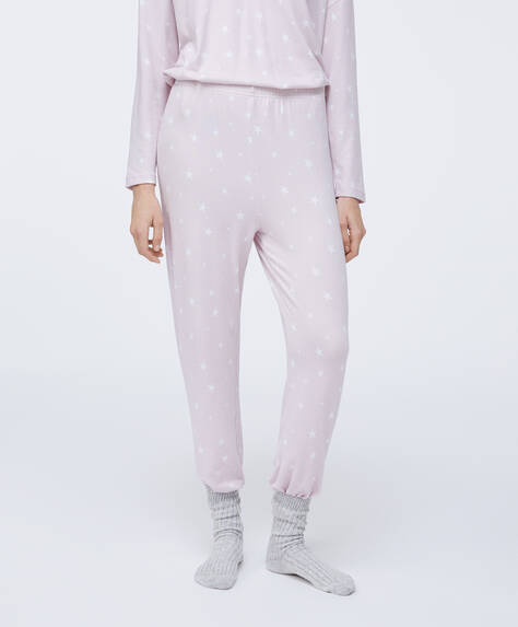 Trousers with stretch waistband. Soft touch fabric with star print on a mauve background.
