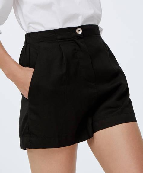 Korte zwarte broek