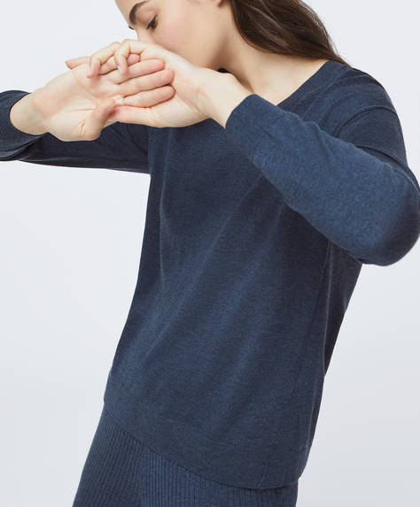 Fine-knit jumper with long cuffed sleeves and V-neck.