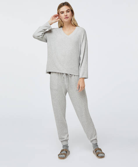 Soft touch trousers with adjustable elasticated drawstring waist. Side pockets. Ankle cuffs.