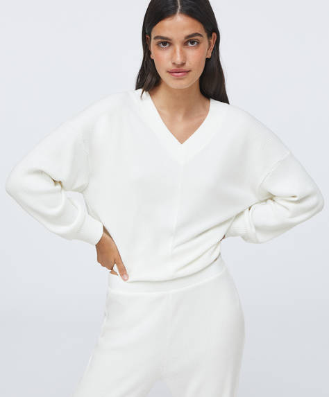 Long-sleeved soft touch jumper with cuffed sleeves and V-neck.