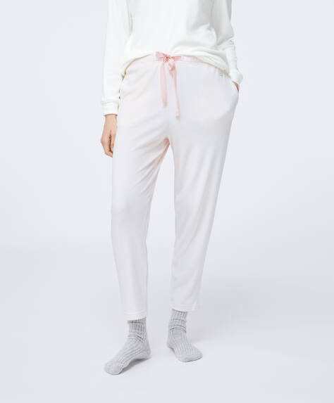 Trousers with stretch waistband and drawstring waist. White stripe print on a pink background.