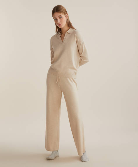 Ribbed fine-knit straight-leg trousers with elasticated drawstring waist. No pockets.