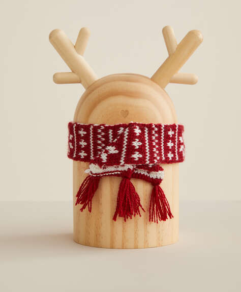 Wooden reindeer with a pair of socks