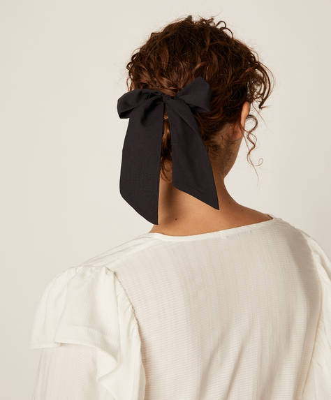 Black scrunchie with bow detail.