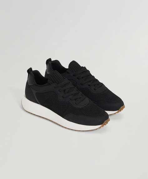 Chaussures de sport en construction textile élastique à lacets