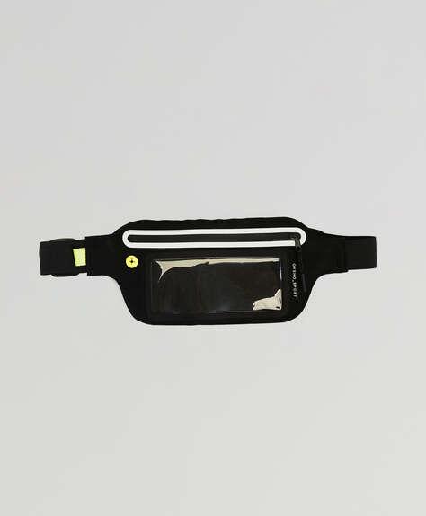 Belt bag for running. Touch-screen. Earphone port and transparent pocket. Adjustable strap. Measurements: 21 x 12cm