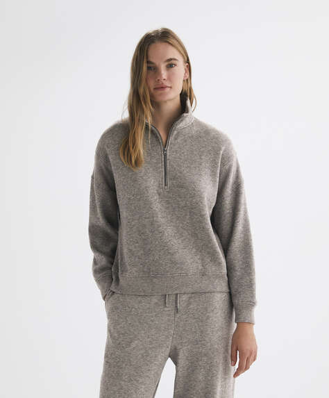 Knit jumper with raised neck