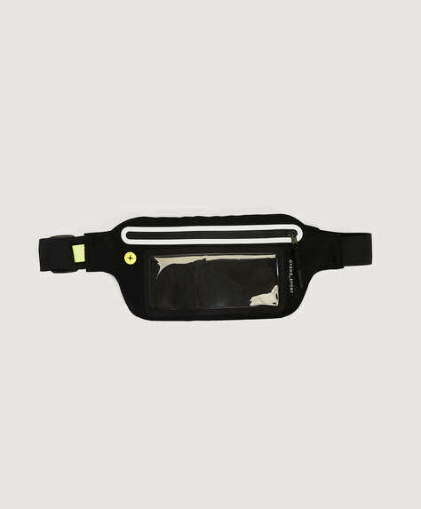 Belt bag for running. Touch-screen. Earphone port and transparent pocket. Adjustable strap. Measurements: 21 x 12cm