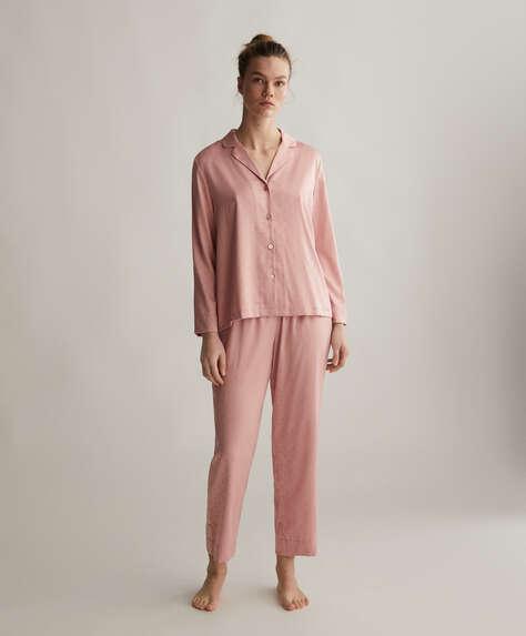 Spodnie w drobny różowy deseń w serduszka